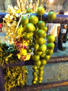 limes and flowers left behind by pilgrims